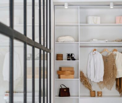 white bath towel on white wooden cabinet